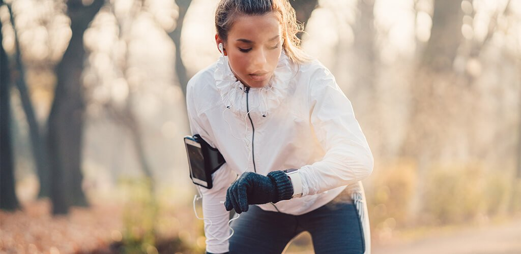 A woman exhaling while working out outside.