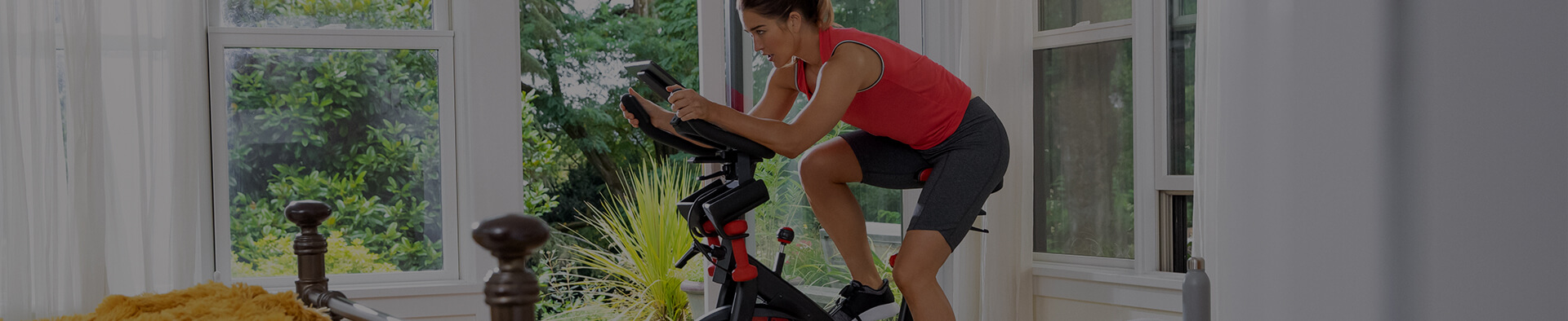 A woman using the Bowflex C6 Bike