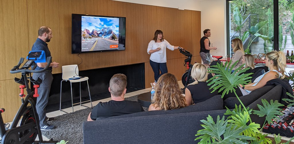 A group of people learning about Bowflex connected fitness.