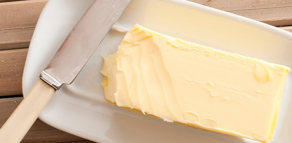 a stick of butter on a dish
