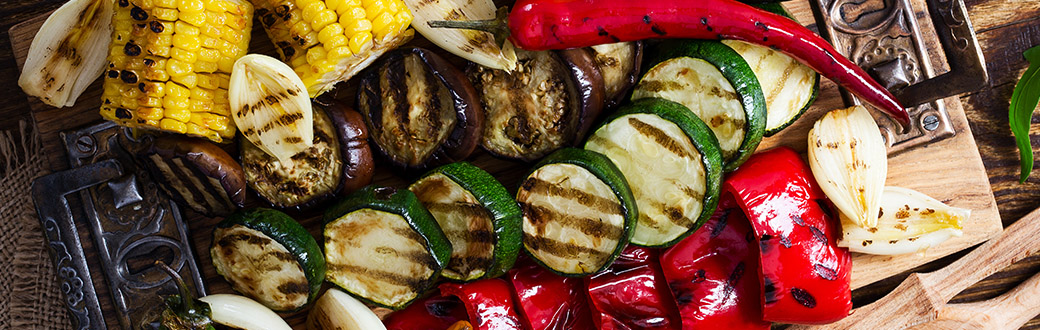 Grilled vegetables on a cutting board.