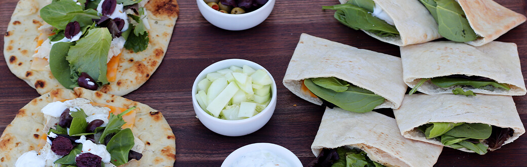 Grilled chicken pitas on a cutting board