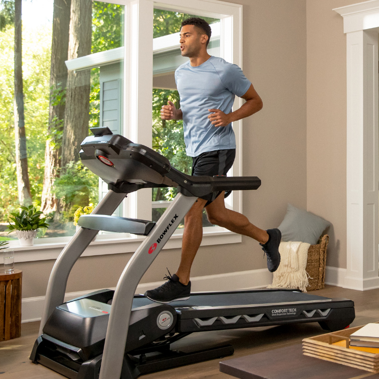 man running on a treadmill indoors