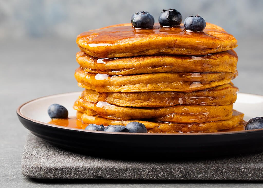 a stack of sweet potato pancakes