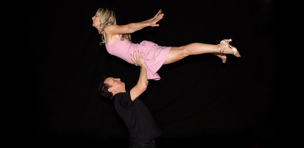 A man and woman performing the lift from Dirty Dancing.