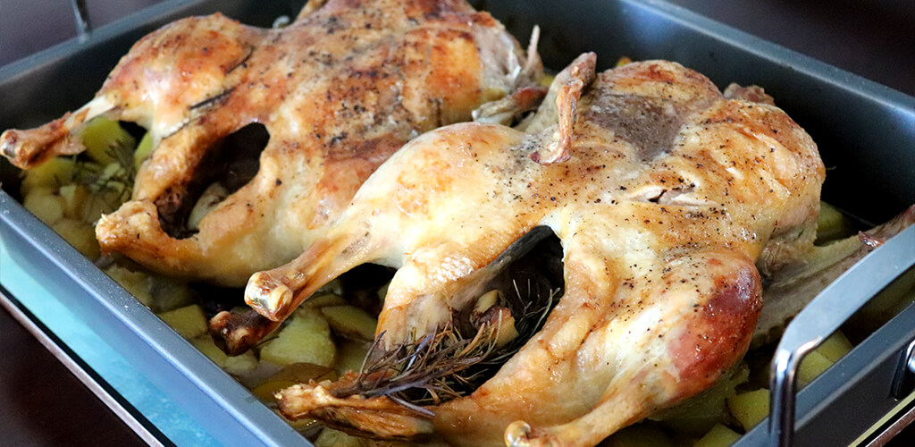 Two roasted ducks.