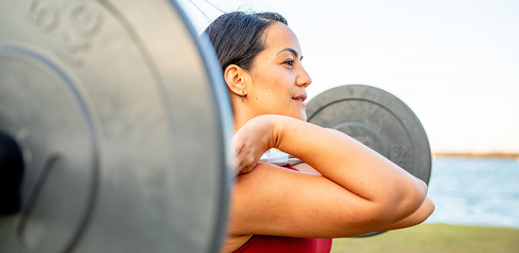 A woman using a barbell