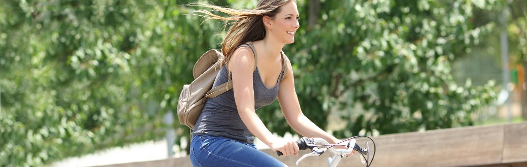 A woman riding a bike.
