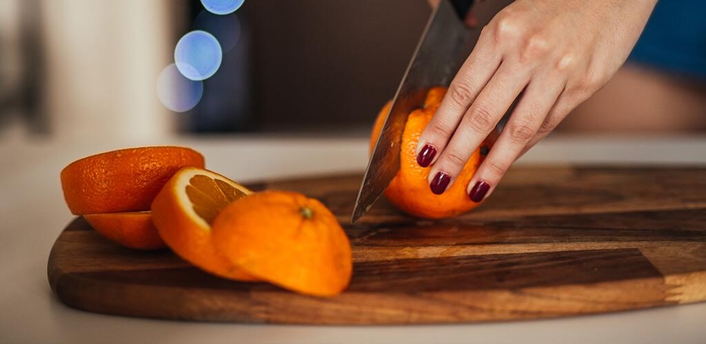 An orange being sliced.