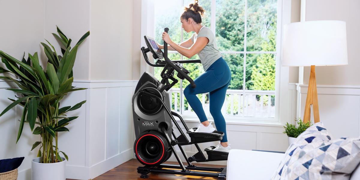 A woman using a Bowflex Max Trainer M9.