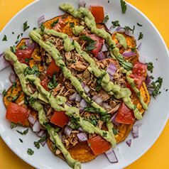 A plate of loaded sweet potato nachos