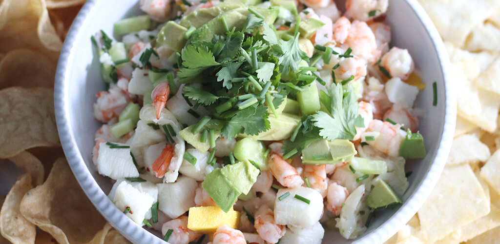 Sea bass and shrip ceviche in a serving dish.